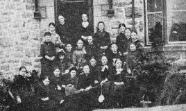 <p>A group of pupils in the 1880s sitting outside the school. </p>