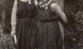 Two girls wearing their everyday uniform.  <br>This image is from Gillian Spencer's collection. Gillian went as a boarder to DWS aged 8 in 1929. </p>