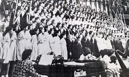 <p>Members of the DWS Choir took part in the National Eisteddfod 1949.  The group of twelve, were known as the Parti Deuddeg.  Mrs Thomas (DWS Head of Music), is at the piano.