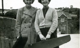 <p>Betty Thomas & Tegwen Jones members of the orchestra for the 1949 Eisteddfod and on their way to practice. </p>