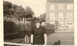 Elspeth playing tennis at Main School