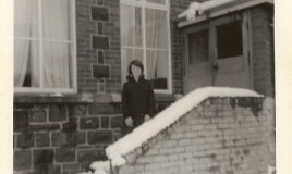 <p>Liz Evans on snowy steps in front of the Music room at the Main School