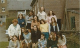 <p>Taken next to tennis courts. Possibly Upper 5th form, summer term. Familiar faces are Meryl Davies (Right end on 2nd row), Elspeth Webb (2nd from right on back row), Eirian Davies (On right end of middle row) and Maggie Williams (On bottom row, 3rd from right) </p>