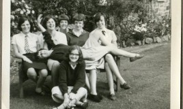 Day girls posing: <br> The rose garden - we couldn't keep away..... <br> <p>L-R  Catrin Dwyryd, June Davies, Jennifer T, Lyn Davies, Nesta Roberts. </p> <p>Ellen Rees (lying across knees)  Front:  Phyll Jones </p>