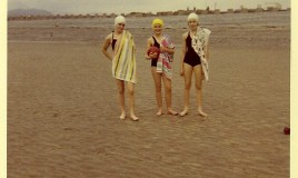 <p>(L-R)  Elizabeth Chapman, Sue Crowther and Lynne Moorhouse posing on the beach at Fairbourne, during a going out weekend.We are wearing our regulation swimming costumes and caps.