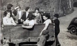 <p>This picture was in an album donated to Meirionnydd Archives of photographs taken in the 1930s.  The school had a beach hut at Friog which the pupils could use and here they are being driven back to school. </p>