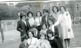 <p>Group pose outside the tennis courts in 1962.  In the picture from left to right: Eleri Williams, Aerona Jones, Eifiona Ashton, Mair W Jones, Nesta Wyn Jones, Beryl Ashton, Yvonne Nichols, Eurwen Evans, Ann Wyn Jones, Jenifer Davies, Carol Price, Eluned Edwards, Angela Bowler. </p>