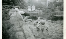 <p>Swimming in the freezing cold waters of Glwyn Malden swimming pool.  The water was taken from the steam to fill the pool. In the picture is Jane Wallace with a ball on her head.