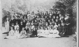 <p>The school opened on 8th February 1878 with Miss Emily Armstrong as the first headmistress. There were 19 boarders in the first term. Eluned Morgan (writer) and Margaret Owen (later to become Margaret LLoyd George) were pupils while Miss Armstrong was in charge. This photograph shows staff and pupils. </p>