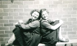 Gwenan ? and Tegwen Harris Jones sitting together on a bench outside the classrooms
