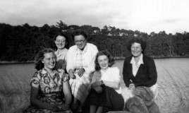 An image of the music staff, 17 July 1951, taken at a Choir and Orchestra picnic at Cynwch Lake. Left to right: Miss Hill, Miss Carrington-Jones, Mrs Thomas, Miss Cusick, Mrs Cox.