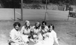 <p>6th formers enjoying a break in the sun and chatting with the laundress by the tennis courts on the main school site. Does anyone know her name? 
