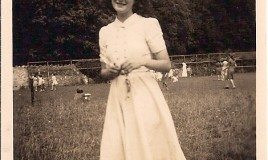 <p>Novello Evans (Riley) is posing on the hockey pitch, with what looks like a game of rounders going on in the background. You can see a matron or nurse in a white uniform possibly supervising the game and two of the young boys who attended Tremhyfryd at that time. </p>