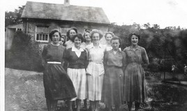 <p>This 'dormy' was at Penycoed and situated at the front of the house on the right hand side as you went up the stairs. The photograph was taken outside the Laundry and near the Main School's tennis and netball courts. Anne Lloyd Davies was head of 'Poppy', she describes them as a super group of girls. </p>