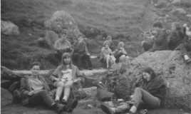 Relaxing after trekking up Snowdon. <br>Susan Crowther, Susan Mallett and Janet Davies in the foreground. Mr Peel and Miss Edwards? behind. </p>