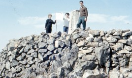 <p> From an original slide transparency, Mr Peel (Geography teacher) and two female staff members flying the flag on top of Cader Idris in the late 60's early 70's.