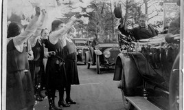 <p>The car stopped briefly at the school gate. Nans Williams held out the visitors book for the Prince to sign. Pupils lined the main road and the Headmistress (Miss Anstey), the Governors and staff were presented to him.  </p>