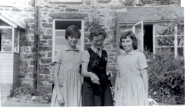 <p>Group standing in front of Tremhyfred, the staff house - Ann Taylor, Ann Richards and Nesta Wynne Jones. Ann Richards Is holding Jack - a jackdaw who she raised from a real baby when he was found having fallen out of the nest. Eventually he flew free. </p>