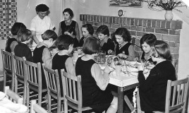 "A group of girls eating around a table at Glyn Malden,the junior school. The picture was posed for the visit by a reporter from the Daily Post in 1956, see the story ""A Reporter Visits the School"". Picture courtesy of The Daily Post."