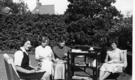 A group of four girls having tea in the garden at Isgoed, one of the school boarding houses on the Dolgellau to Barmouth Road.