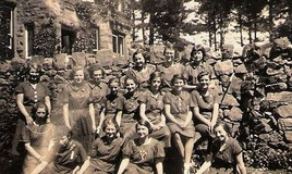 <p>Names faintly written on back:  (Top tier) Ninnette Cable, Pauline Baechly, Jean laudo, (Centre tier) Mary Wilson, Helen Billington, Ruth Stonehouse, Olive Jones, Judy Hughes, Singleton, Morffudd, Ann Pugh. (Bottom row) Irene W?, Paddy Rophy, Thelma Thove, Doreen Davis - as best we can read the faint handwriting. </p>