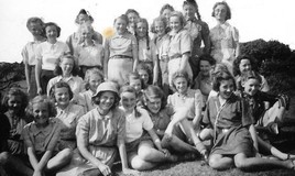 <p>Visit to the Guide camp at Minfford (above Portmeirion) in July 1944 by Miss Orford (headmistress - back row second from left) and Miss Lee (back row far right). Miss Salway and Miss Rees were the Guiders - we had a glorious week weatherwise