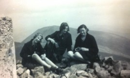 3 girls enjoying a picnic on the summit of Cader Idris.