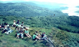 <p> From an original slide transparency, pupils from Llys Mynach having a picnic on the Precipice. In school uniform and not a walking boot in sight!  Identified pupils Meryl Davies, Morfydd Rees. 