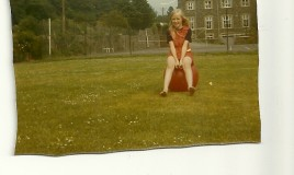 The Space Hopper was very popular in the late 1960s. This picture, taken on the school playing field, also shows the tennis courts and the school hall in the background