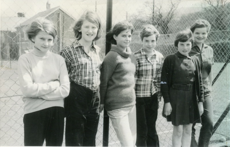 Group from the late 60's outside tennis courts