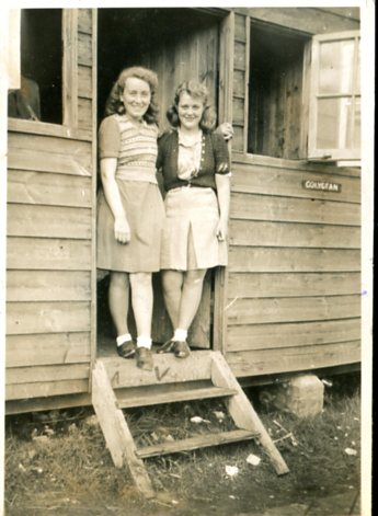 Two outside the Beach Hut in the 1940's