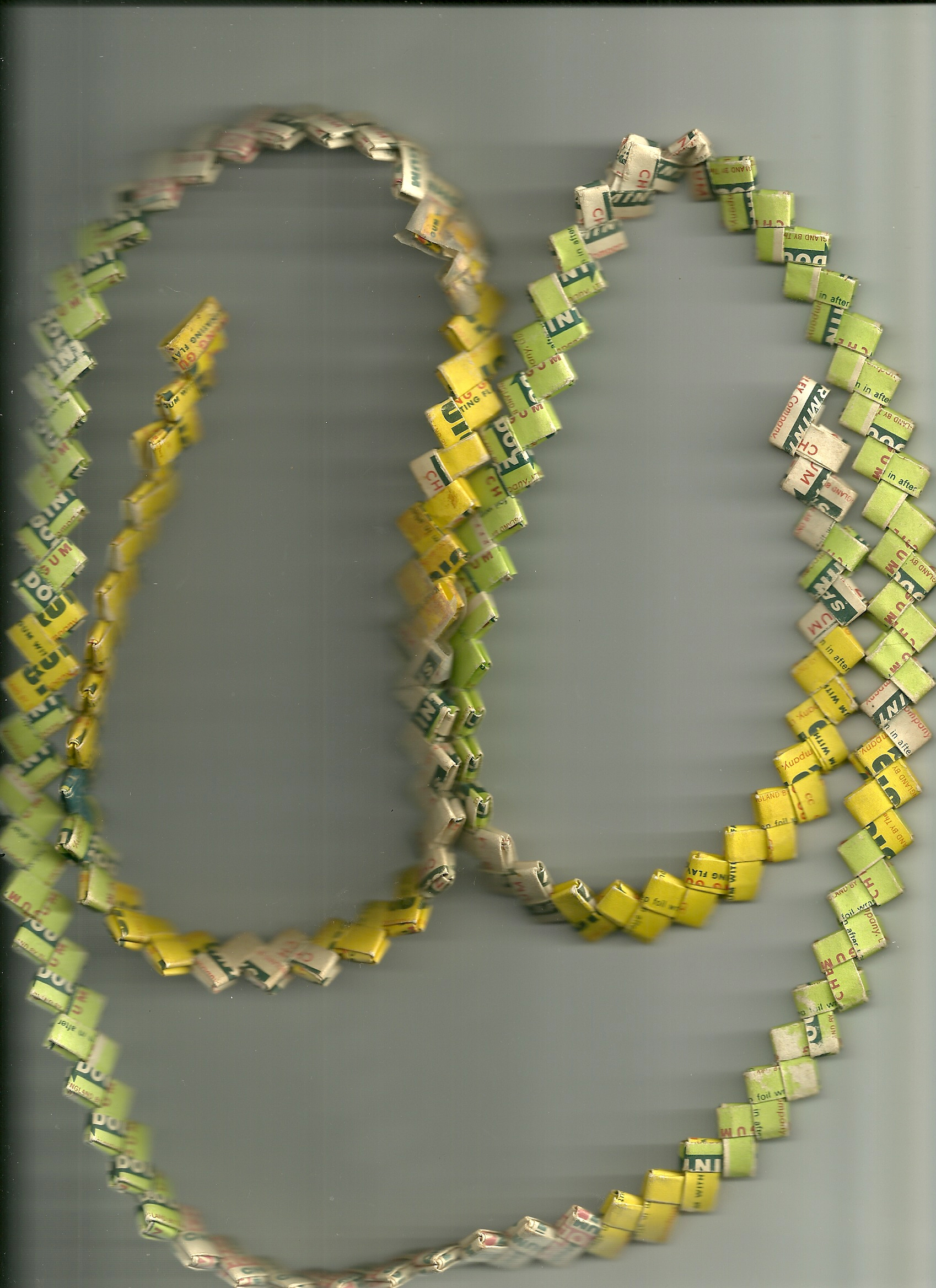 A neatly folded chain of chewing gum wrappers forming a 'love chain'
