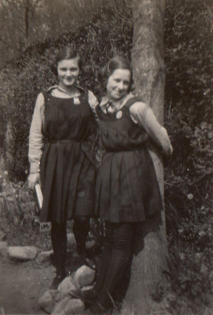 Two girls wearing school gymslips and black stockings 1930s