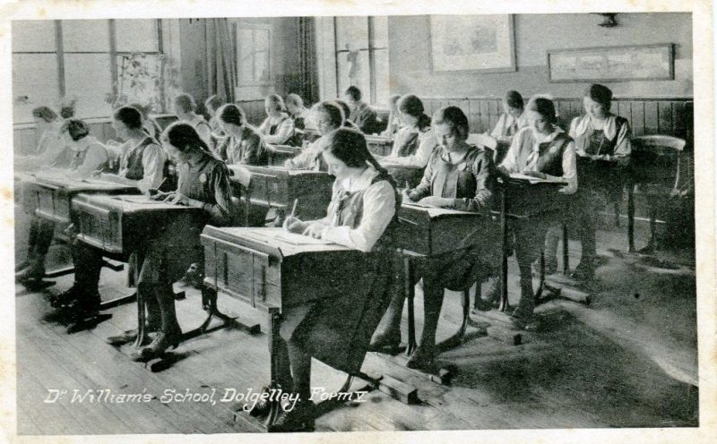 Girls working in Form V classroom, postcard circa 1920