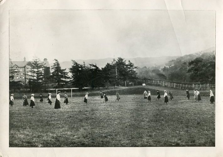 Hockey practice early 20th century. Find the ball!