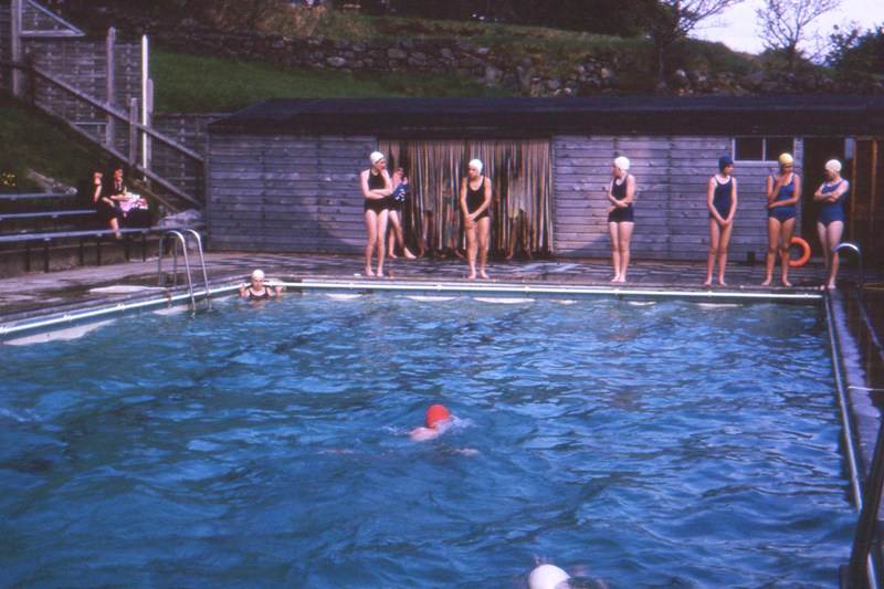 Swimming pool view with pupils and two spectators 1960s