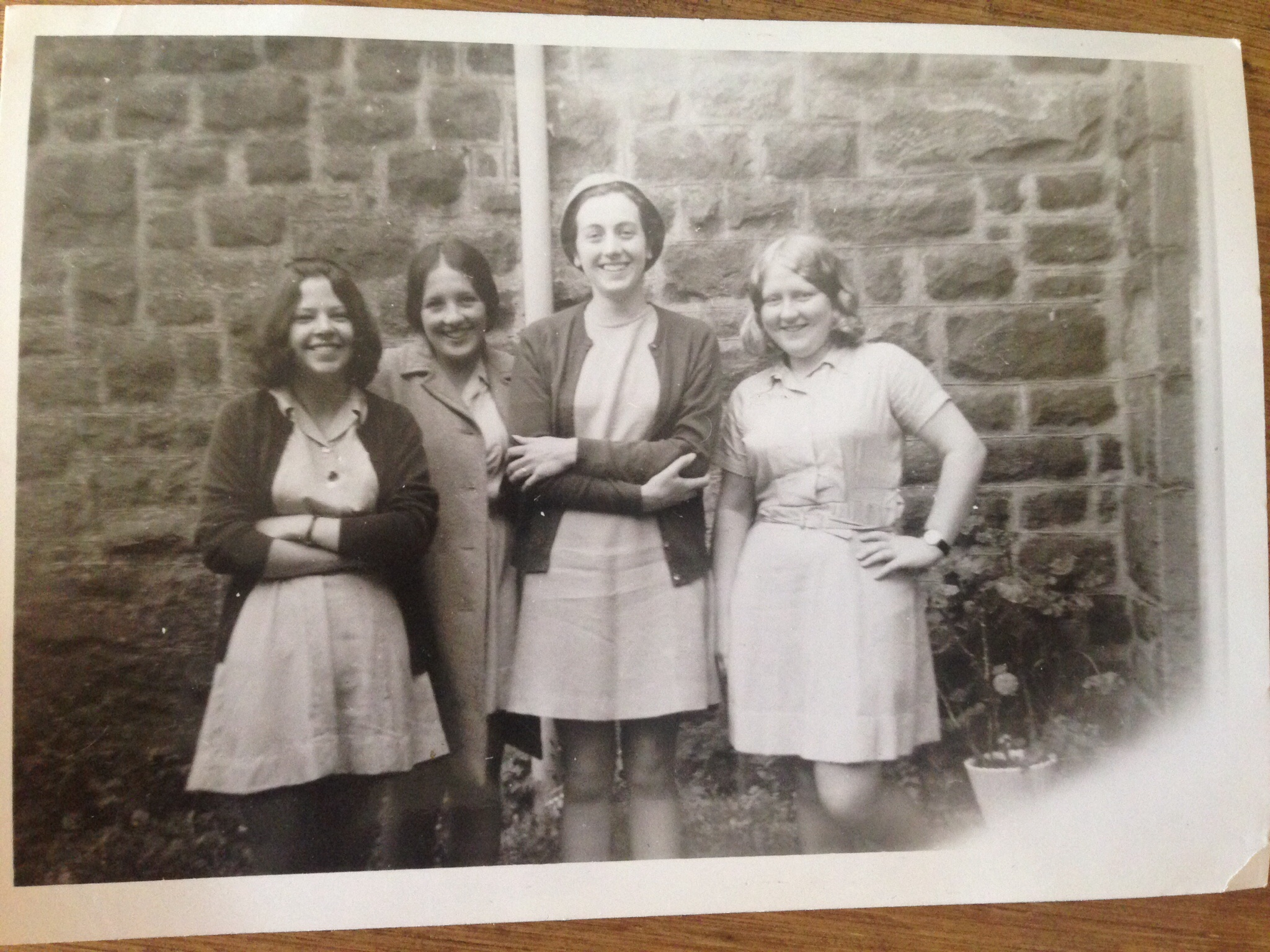 Three pupils and the Domestic Science Teacher circa 1970