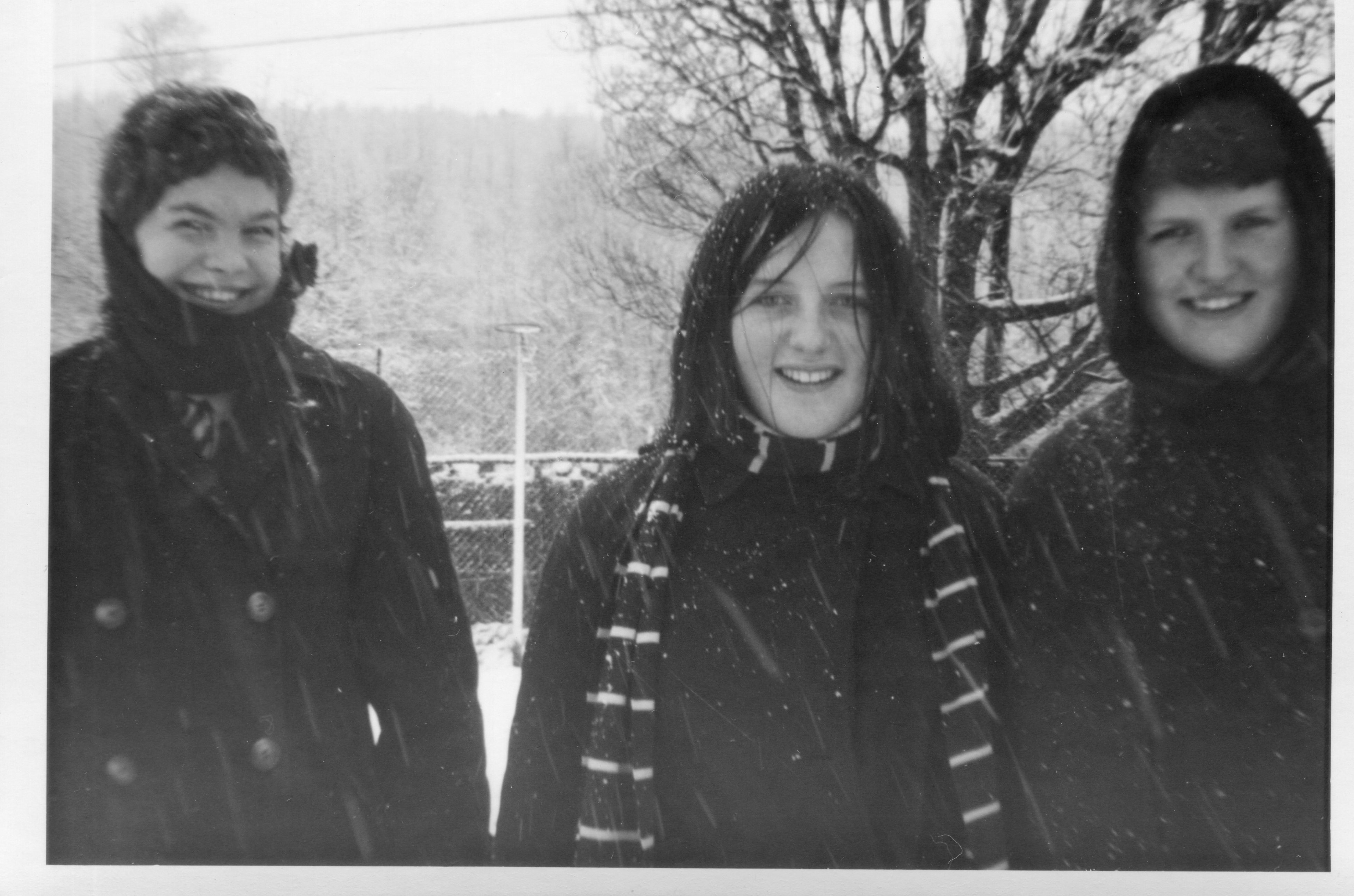 Winter photograph of three girls, circa 1960