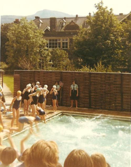 School swimming pool with swimmers and audience